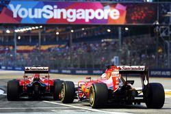 Sebastian Vettel, Ferrari SF15-T and Kimi Raikkonen, Ferrari SF15-T at the pit lane exit