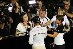 Lewis Hamilton, Mercedes AMG F1 with Lee McKenzie, BBC Television Reporter and Craig Slater, Sky F1