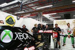 Romain Grosjean, Lotus F1 E23 en un traje overol de Xbox