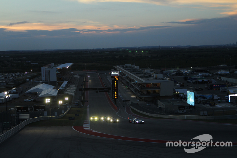 Race action at dusk