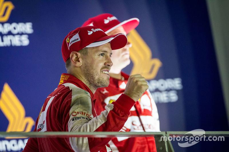Race winner Sebastian Vettel, Ferrari celebrates on the podium
