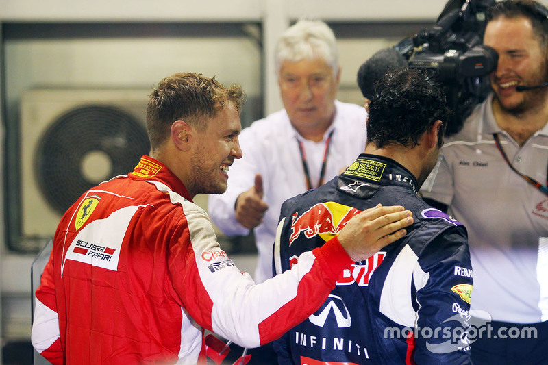 Race winner Sebastian Vettel, Ferrari celebrates in parc ferme with second placed Daniel Ricciardo,
