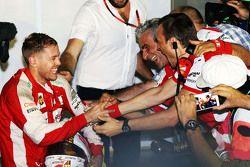 Race winner Sebastian Vettel, Ferrari celebrates with Maurizio Arrivabene, Ferrari Team Principal in parc ferme