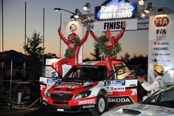 Winner: Pontus Tidemand and Emil Axelsson, Skoda Fabia S2000, Team MRF celebrate their victory