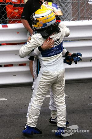 Race winner Pastor Maldonado celebrates with Giorgio Pantano