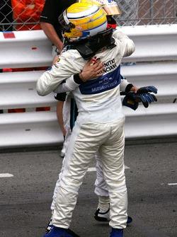 Race winner Pastor Maldonado celebrates with Giorgio Pantano