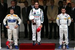 Podium: race winner Pastor Maldonado with Giorgio Pantano and Timo Glock