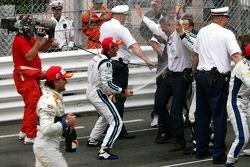 Champagne for Timo Glock and Pastor Maldonado