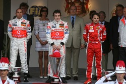 Podium: race winner Fernando Alonso with Lewis Hamilton and Felipe Massa