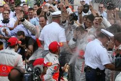Team and photographers in the spray of the champagne from Fernando Alonso, McLaren Mercedes and Lewi