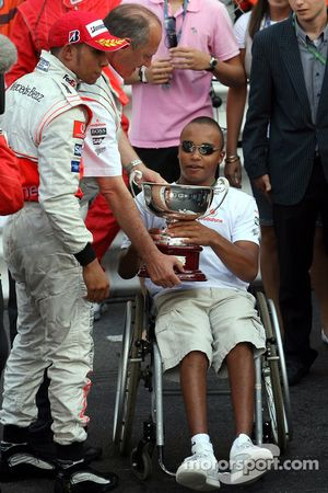 Nicholas Hamilton, Brother of Lewis Hamilton gets the trophy from Ron Dennis, McLaren, Team Principal, Chairman dirkt after the Podium ceremony