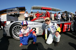 Young fans pose with the Audi Sport Team Joest Audi R10