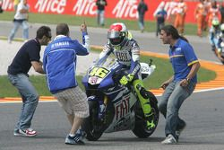 Race winner Valentino Rossi takes the checkered flag