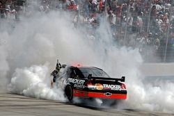 Race winner Martin Truex Jr. does a burnout