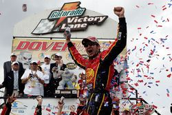 Victory lane: race winner Martin Truex Jr. celebrates
