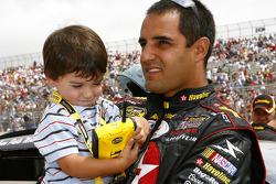 Juan Pablo Montoya holds his son Sebastian