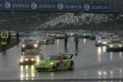 #1 Manthey Racing Porsche 911 GT3 RSR: Timo Bernhard, Marc Lieb, Romain Dumas, Marcel Tiemann leads the field to pace lap
