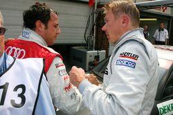Pole winner Mika Häkkinen is congratulated by Timo Scheider