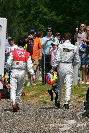 Paul di Resta and Mike Rockenfeller walk back after accident