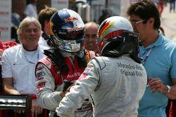 Race winner Bernd Schneider is congratulated by second place Martin Tomczyk and third place Mattias