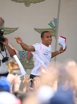 Lewis Hamilton, McLaren Mercedes throws a baseball cap to the fans