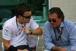 Fernando Alonso, McLaren Mercedes talks with Giancarlo Minardi