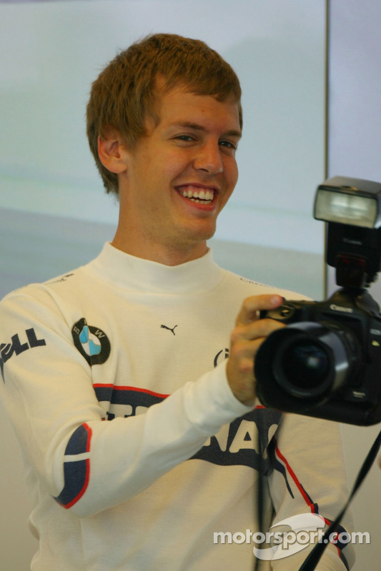 Sebastian Vettel, Test Driver, BMW Sauber F1 Team in the Team Garage, takes the camera of Daniel Reinhard
