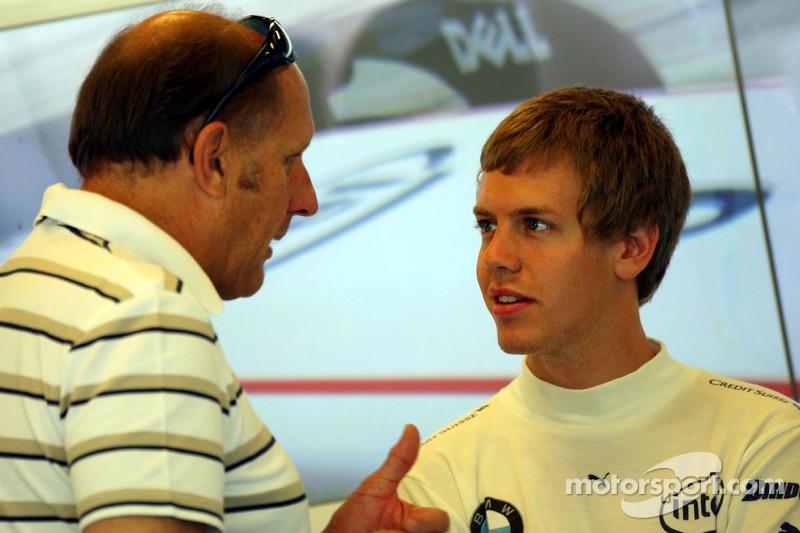 Sebastian Vettel, Test Driver, BMW Sauber F1 Team in the Team Garage talks with Hans Joachim Stuck