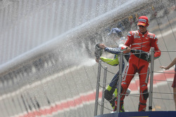 Podium: champagne for Casey Stoner and Valentino Rossi
