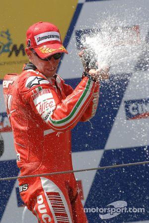 Podium: champagne for Valentino Rossi