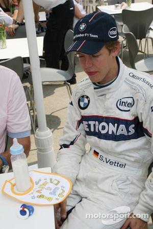 Sebastian Vettel, Test Driver, BMW Sauber F1 Team, is presented a bib saying