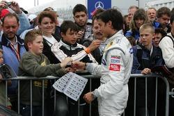 Pole winner Bruno Spengler celebrates with his fans