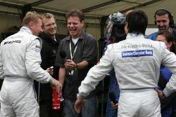 Pole winner Bruno Spengler celebrates with Mika Hakkinen
