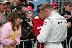 Mika Hakkinen signs autographs