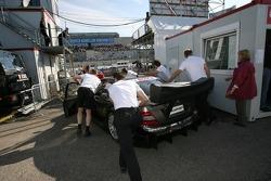 Team HWA AMG Mercedes, AMG Mercedes C-Klasse of Mika Hakkinen is pushed to the pitlane