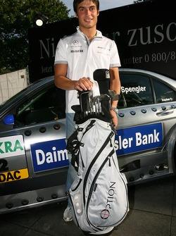Bruno Spengler receives his new custom-built golf clubs