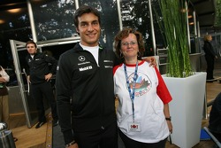 Bruno Spengler poses with a member of his German fanclub