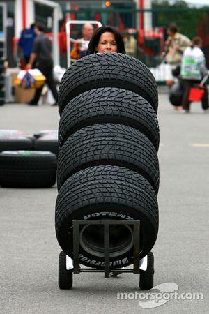 Tanja Bauer, pushes tyres around padok