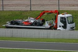 Car, Lewis Hamilton, McLaren Mercedes is returned to pitlane after stopping, track