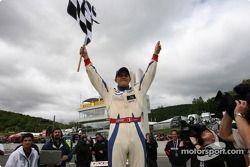 Race winner Franck Perera celebrates