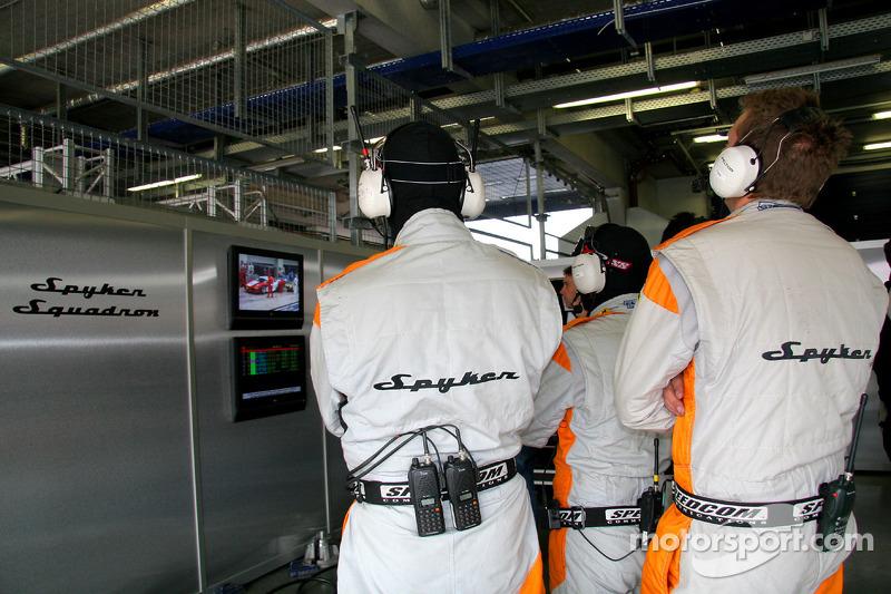 The Spyker crew looks on