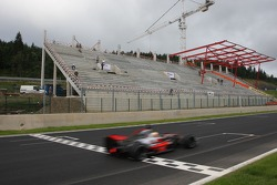 New main grandstand in the build, Lewis Hamilton, McLaren Mercedes is passing