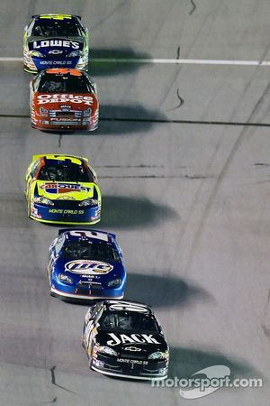 Clint Bowyer leads the field thru the tri-oval