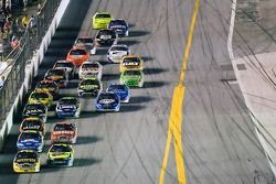 Jamie McMurray and Kyle Busch race back to the start finish line