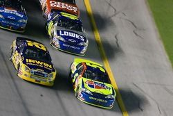 Jamie McMurray and Kyle Busch race back to the start-finish line