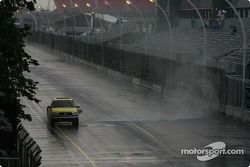 The jet dryer truck tries to get rivers of rain off the track