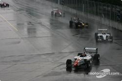 Junior Strous leads a group of cars under yellow
