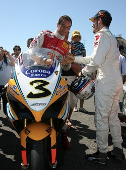 Timo Scheider, Audi Sport Team Abt Sportsline, sitting on the Suzuki GSX-R superbike of Max Biaggi,