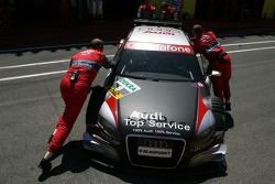 Audi mechanics push the car of Timo Scheider, Audi Sport Team Abt Sportsline, Audi A4 DTM, back into