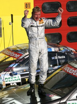 Race winner Mika Hakkinen, Team HWA AMG Mercedes, standing on his car